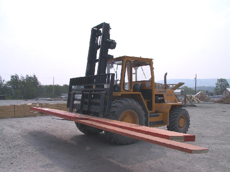 picture of a forklift carrying a unit of laminated veneer beams