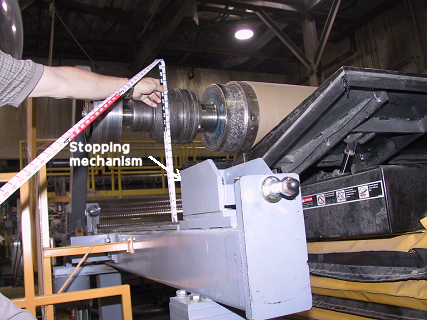 Figure 3 - Shows that during the incident, the steel spool was above the stopping mechanism on the tracks and only held by the tilter