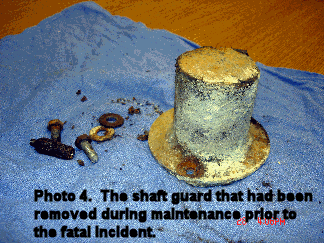 picture of the shaft guard that had been removed during maintenance prior to the fatal incident