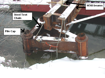 picture of a pile cap that was attached to a pair of W36 I-beams and secured with a 12,000lb stell test chain.