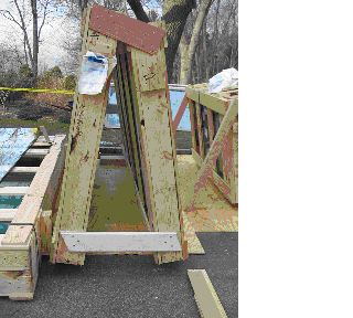 Photo 1 (courtesy of OSHA). The first A-frame that was set up by the workers. The smaller crate supported by the two wooden bars is on the right